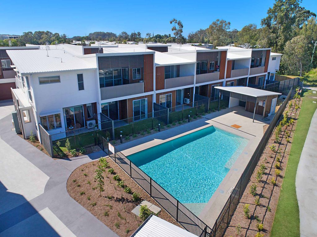 Overview of the dual key rooming development with swimming pool in the foreground.